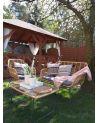 Zestaw rattanowych mebli ogrodowych dla 4 osób - doskonałe na wspólny odpoczynek na świeżym powietrzu.