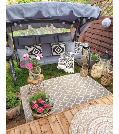 Huśtawka ogrodowa ławka w kolorze grafitowym z moskitierą oraz funkcją rozkładania do pozycji leżącej.