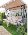Huśtawka ogrodowa ławka beżowa z funkcją rozkładania doskonale sprawdzi się podczas relaksu na świeżym powietrzu.